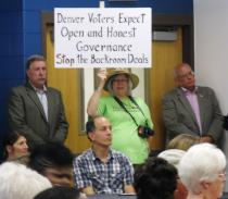 Renee Lewis displays sign during Conference in the City Sep 7